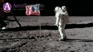 First man on the moon with American flag.